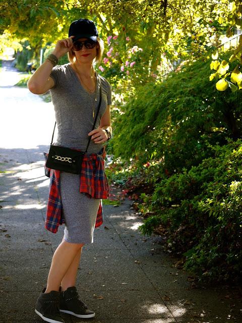 flannel shirt tied around waist