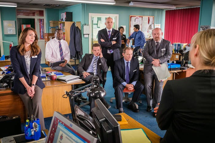 SURANNE JONES as DS Rachel Bailey, DELROY BROWN as DC Lee Broadhurst, LESLEY SHARP as DC Janet Scott, DAVID PROSHO as DC Ian Mitchell, AMELIA BULLMORE as DCI Gill Murray, TONY MOONEY as DC Pete Readyough. L-R Front Row: DANNY MILLER as DS Rob Waddington and DANNY WEBB as DC Chris Crowley.