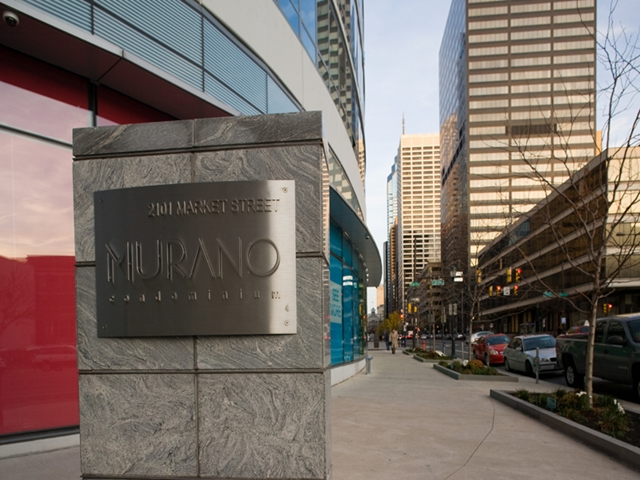The Murano sign on the building as seen from the street