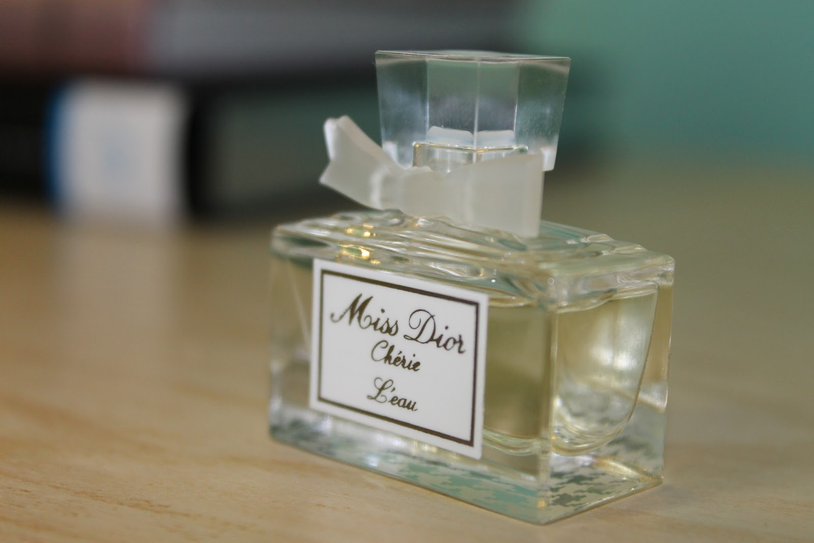 ... Miss Dior Cherie can be. I smell hints of light citrus with sharper  floral notes like gardenia slightly rounded out with a woody 4d8b4fcb43fd2