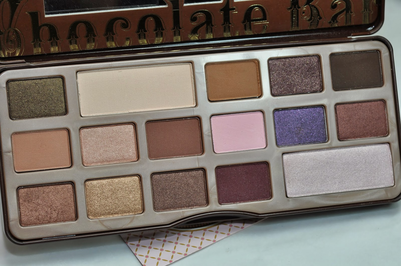 Too Faced Chocolate Bar Palette: Gilded Ganache, White Chocolate, Milk Chocolate, Black Forest Truffle, Triple Fudge Salted Caramel, Marzipan, Semi-Sweet, Strawberry BonBon, Candied Violet, Amaretto Hazelnut, Creme Brulee, Haute Chocolate, Cherry Cordial, Champagne Truffle