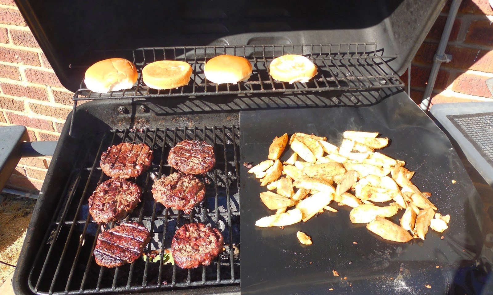 Grilled potatoes and burgers
