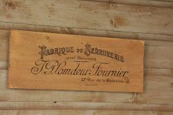 Steigerhouten plank met Franse reclame