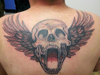winged skull tattoo