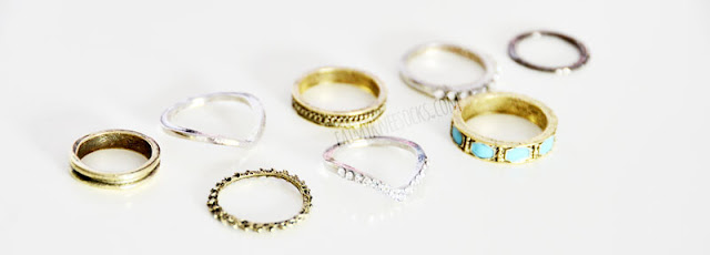 WalkTrendy sells this 8-piece ring set, with a combination of silver, bronze, and black rings.