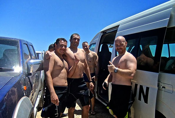 Scuba Diving friends together post dive in wetsuits