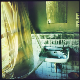 Ghostly curtains and sink in haikyo