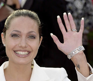 Angelina Jolie letter H tattoo