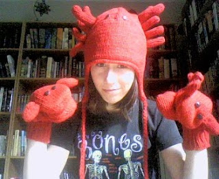 me wearing a woolen lobster hat and mittens
