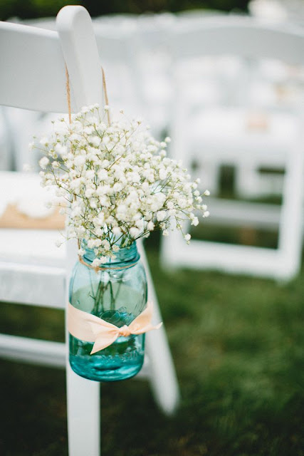 wedding aisle decoration with baby's breath