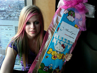 Avril Lavigne and Hello Kitty Skateboard