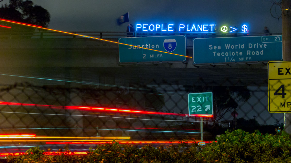People Planet Peace Over Profit - Overpass Light Brigade San Diego
