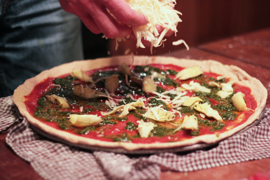 homemade pizza with pesto and artichokes