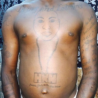 The Fan who tattooed Davido on his body.