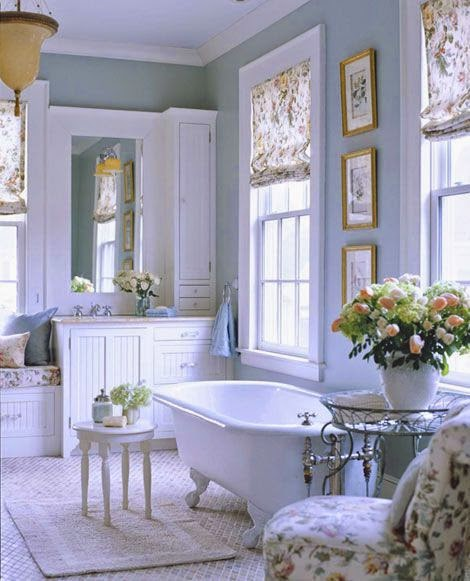traditional blue and white master bathroom with claw foot tub