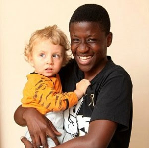 Nelson Fonangwan With Baby He Saved From Burning House