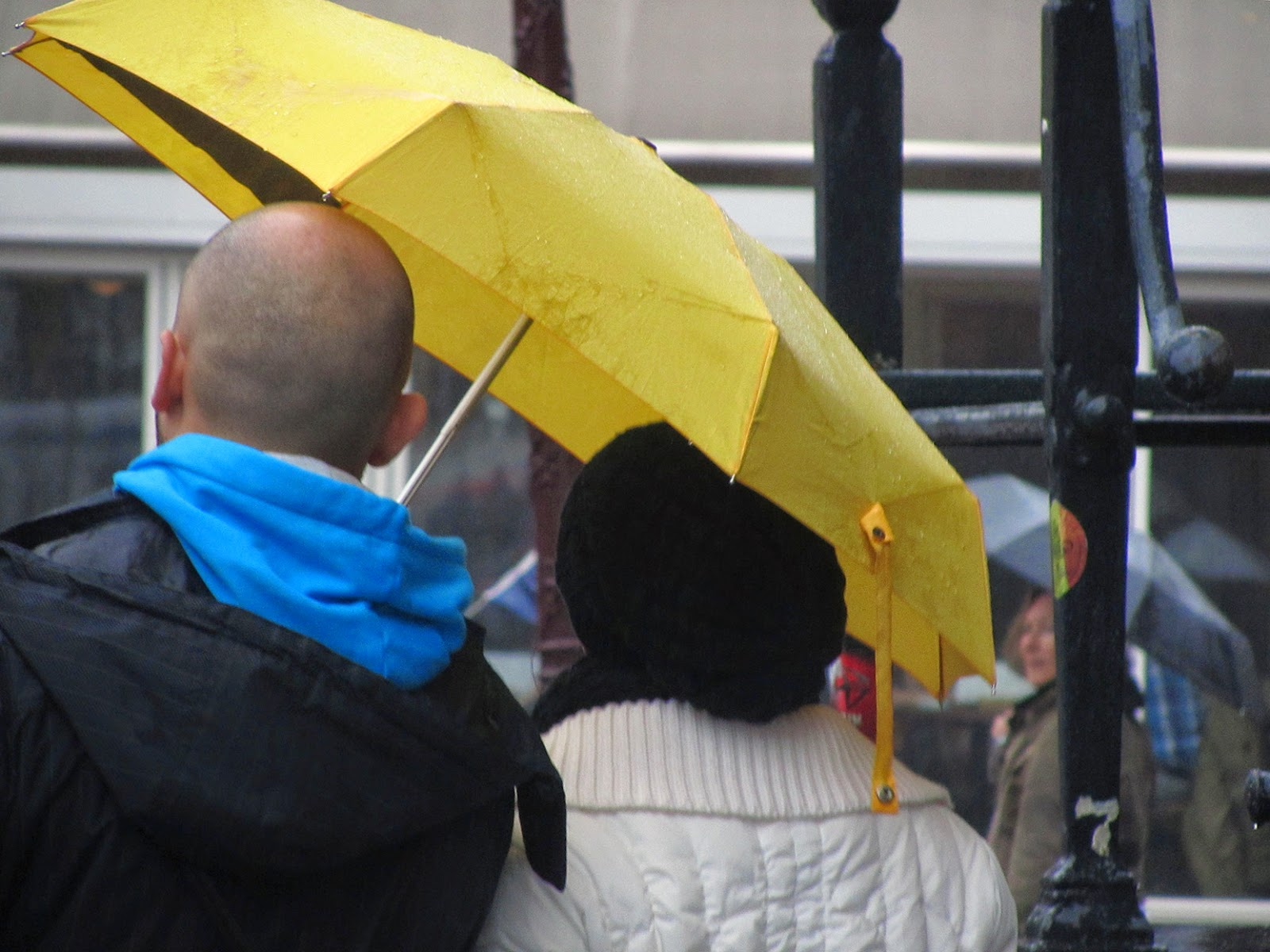 couple under a yellow umbrella