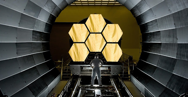 NASA engineer Ernie Wright looks on as the first six flight ready James Webb Space Telescope's primary mirror segments are prepped to begin final cryogenic testing at NASA's Marshall Space Flight Center. Credit: NASA/MSFC/David Higginbotham