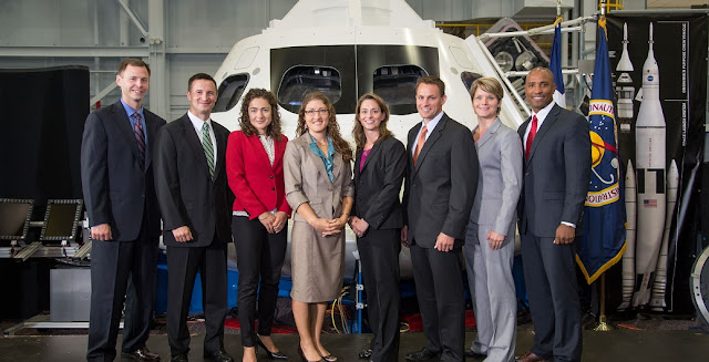 Standing in front of an Orion mock-up in the Johnson Space Center's Space Vehicle Mock-up Facility, the eight-member 2013 class of NASA astronaut candidates, poses for a group portrait during a special media-day event on Aug. 20, 2013. From left to right are Tyler N. (Nick) Hague, Andrew R. Morgan, Jessica U. Meir, Christina M. Hammock, Nicole Aunapu Mann, Josh A. Cassada, Anne C. McClain and Victor J. Glover.  Photo credit: NASA