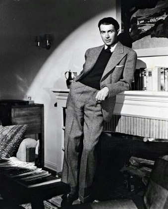 Jimmy Stewart at his fireplace.