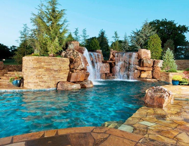 Piscinas con cascadas oasisingular for Modelos de piscinas con cascadas