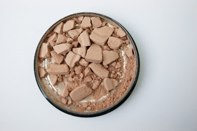Broken compact powder
