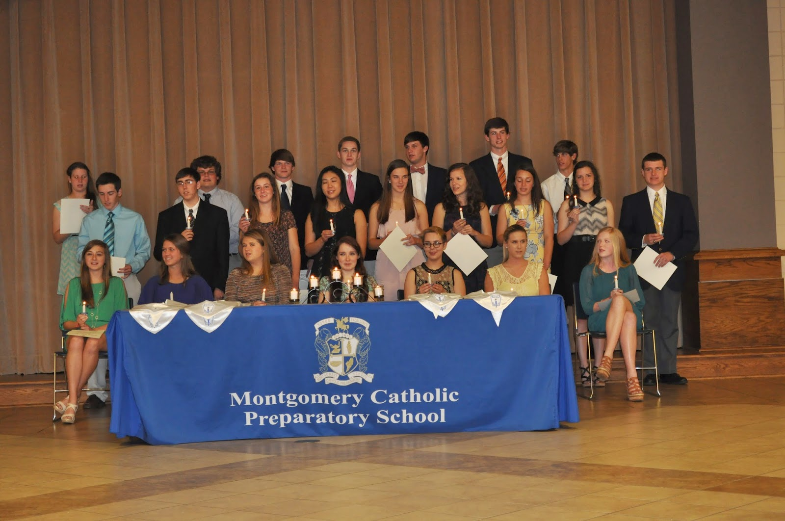 NHS at Montgomery Catholic Preparatory School inducts 22 new members. 1