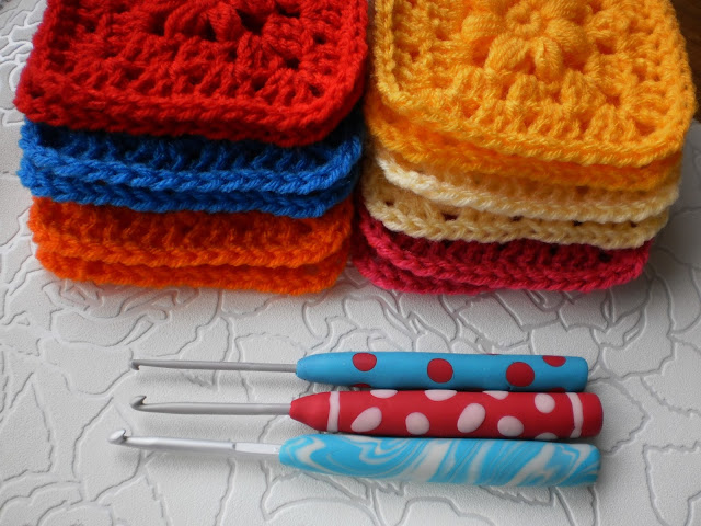 Crochet hook polymer clay handle with some granny squares