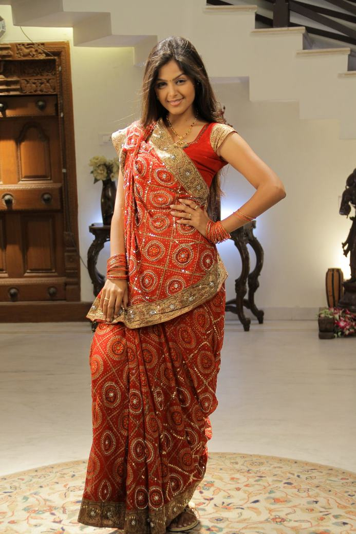 Beautiful hot Monal gajjar in red traditional saree