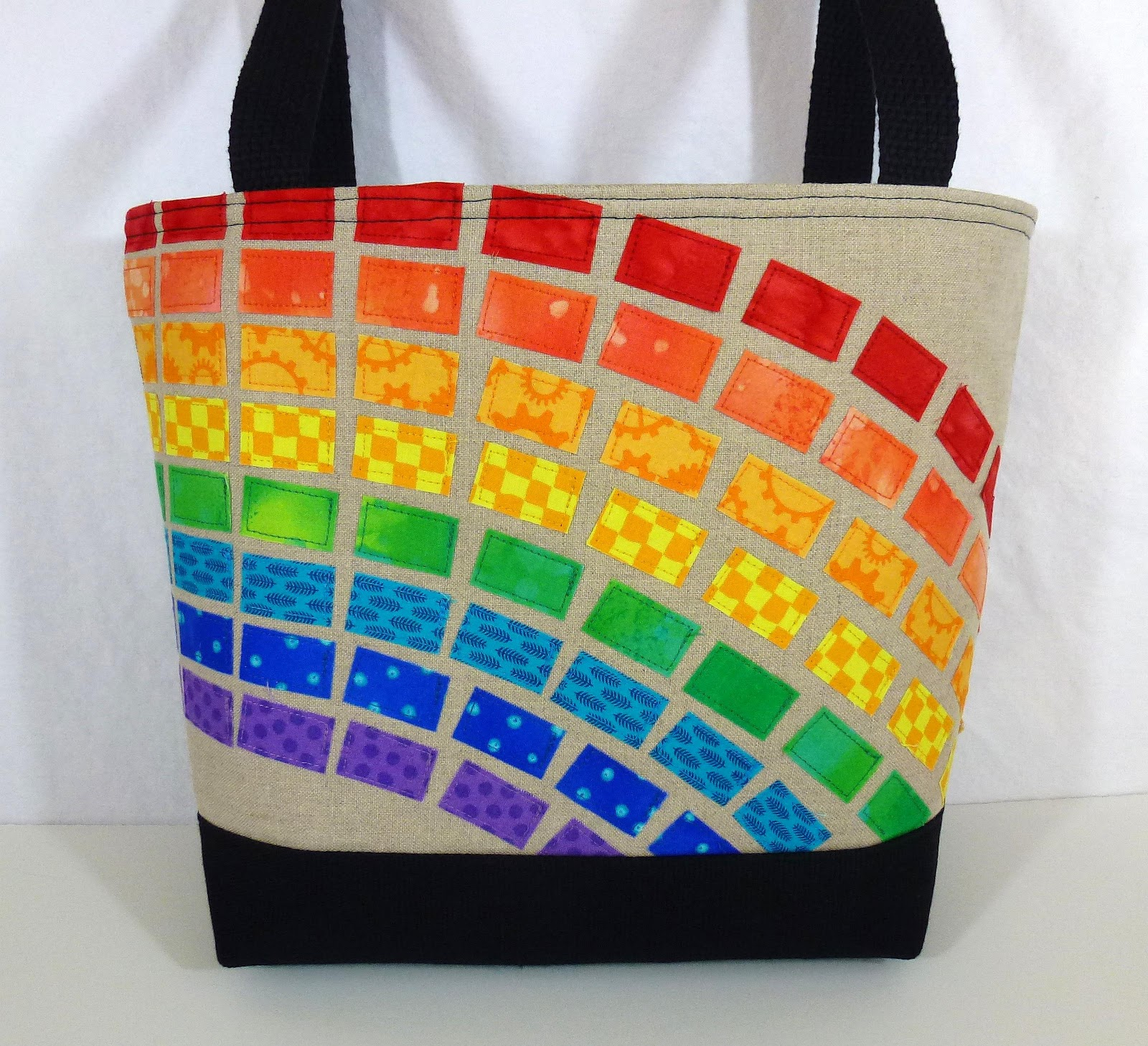 The Back Of Bag Features One Great Rainbow Pocket
