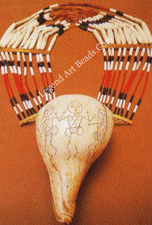 This man's necklace is from the Angami tribe and is an ceremonial ornament. The conch shell bears an interesting motif of dancing figures.