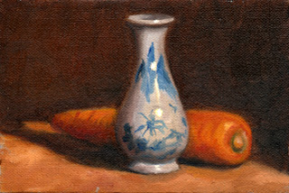 Oil painting of a miniature blue and white porcelain vase beside an orange carrot.
