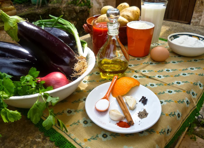 Ingredients for the recipe: eggplants, potatoes, onions, olive oil, ground cheese, milk, flour, egg and spices