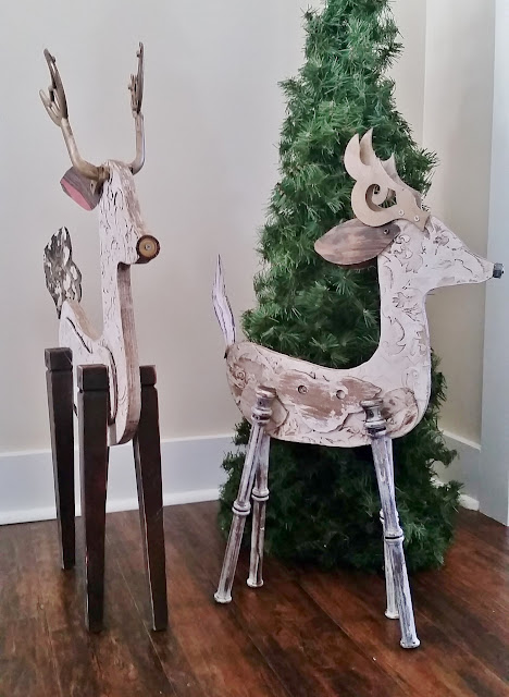 large wood reindeer sculptures, recycled elements