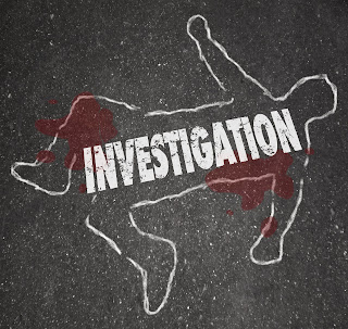 A body outline with blood at a crime scene.