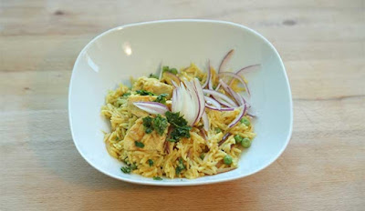 Heat the oil in a large pot and fry the chicken thighs skin Biryani Pilau Recipe