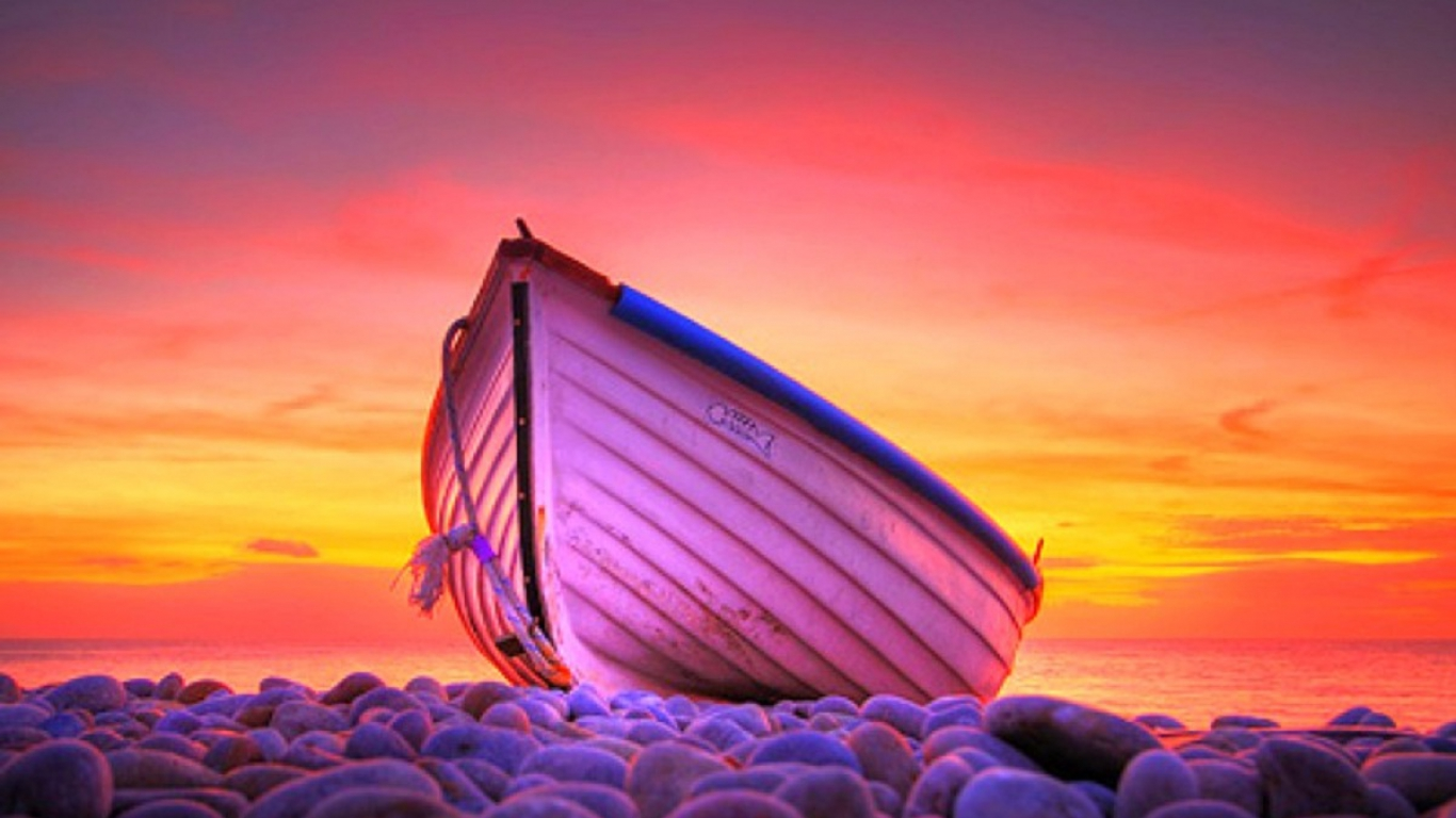 http://1.bp.blogspot.com/-r0yBUE_17SQ/UAa-feOWzQI/AAAAAAAACpc/K6ArHPrkWDE/s1600/boat-on-the-beach-with-sunset-behind-it.jpg