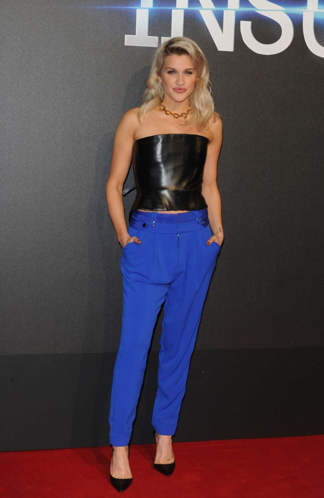 Ashley Roberts in a leather cropped top and blue trousers at the 'Insurgent' London premiere