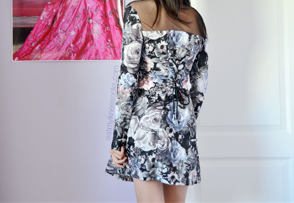 The combination of sexy mesh paneling and flirty floral prints make this lace-up Romwe dress a hit!