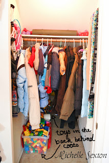 toys are stored in the back of the closet behind the coats