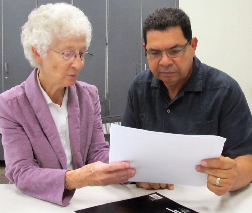 Photo of Sister Georgene Faust tutoring Rio Salado student Nicolas Lopez