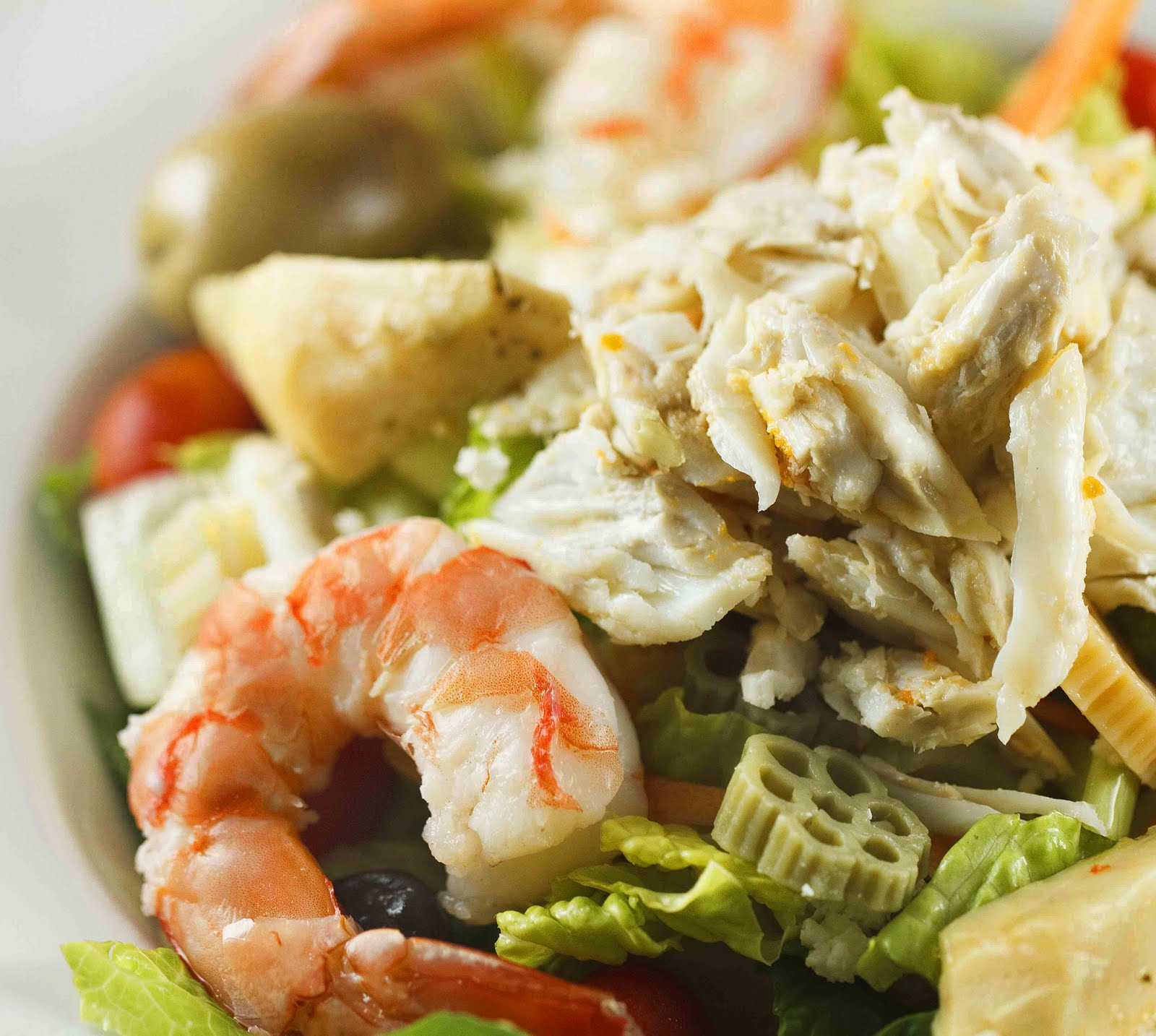 Prepare an original salad with crab sticks and croutons