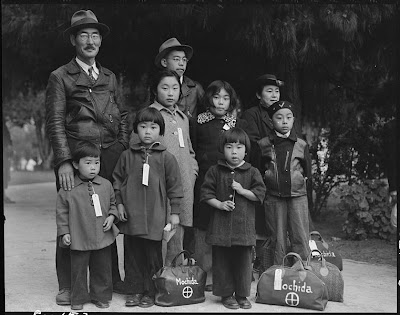 Photograph of Members of the Mochida Family Awaiting Evacuation (Wikipedia)