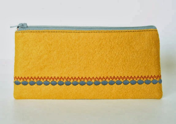 http://folksy.com/items/4419442-Mustard-Yellow-Clutch-Purse-Wool-Felt-Wallet-in-Yellow-and-Grey