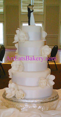 Five tier white magnolia wedding cake