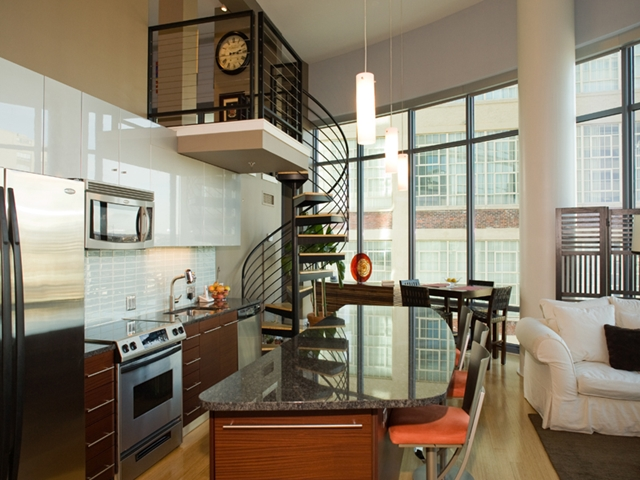 Photo of small kitchen with the stairs to next floor