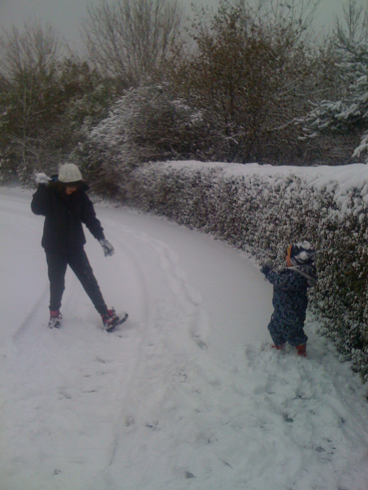 Isaac and Abbey having a snowball fight - December 2010