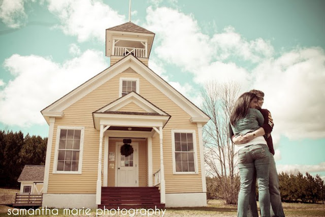 couple standing in front of James School