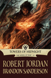 Cover of Towers of Midnight, featuring a dark-haired, bearded white man holding a flaming a war hammer as a shadowy battle rages around him.