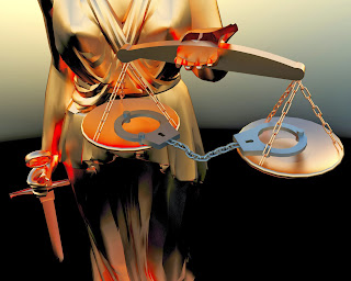Photo of the scales of justice balancing a pair of handcuffs.